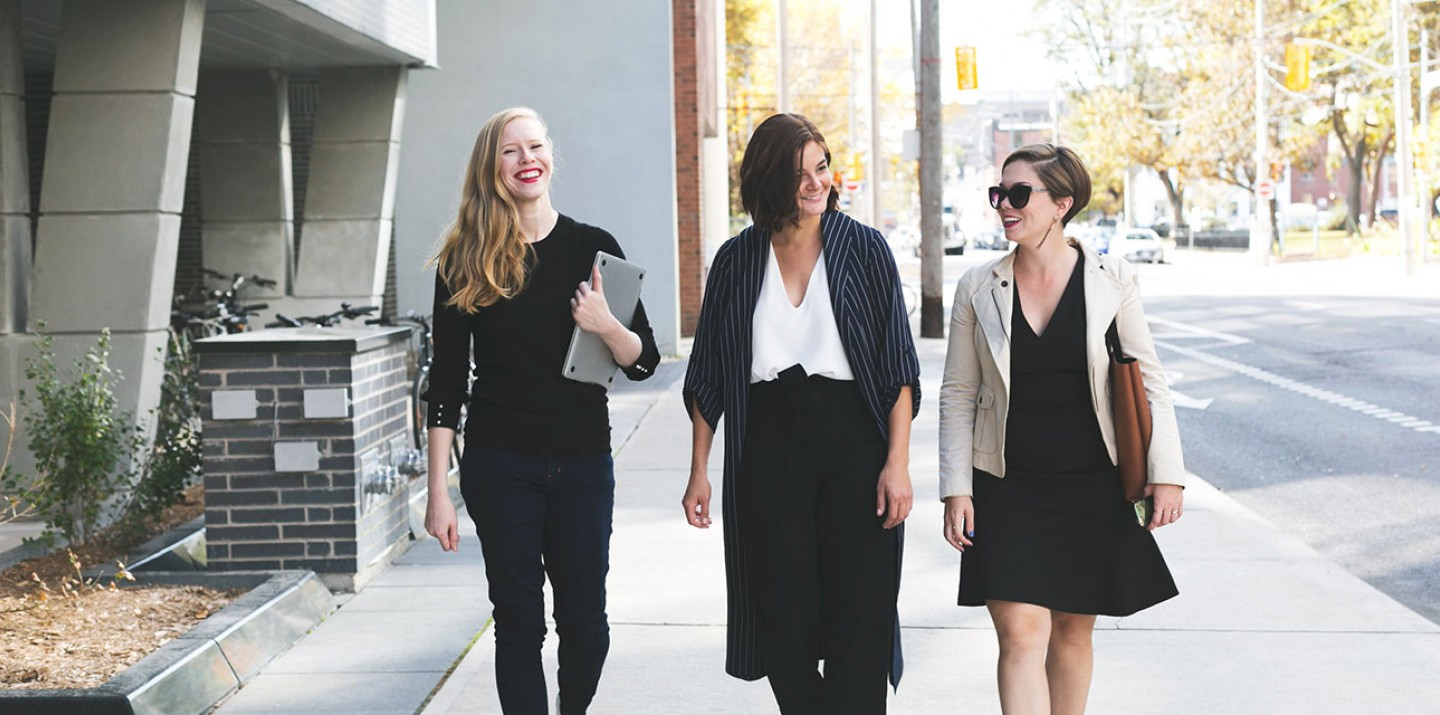 Business women walking down the sidewalk