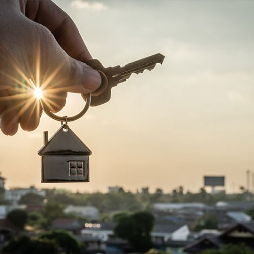 House keychain overlooking a city